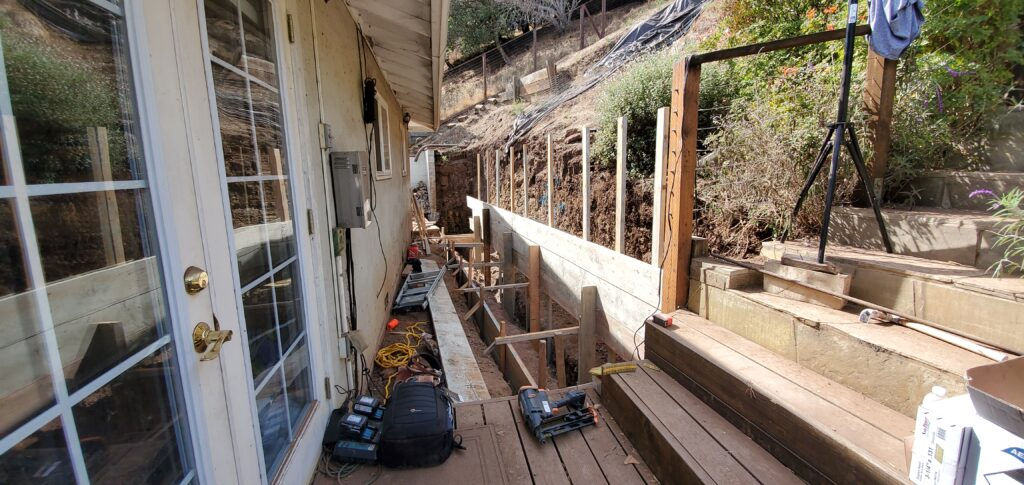 How to build back of concrete retaining wall